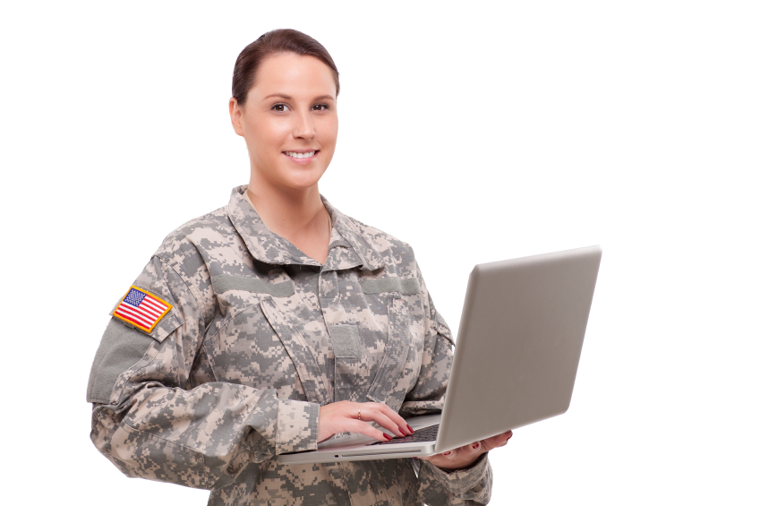 Portrait of a female soldier using laptop
